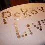 Даёшь выход на международный уровень!!! Для надписи использовано 80 монет из 38 стран мира. И ещё большая гора справа :)